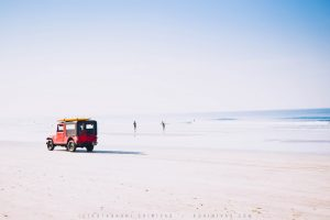 Red Jeep on Beach