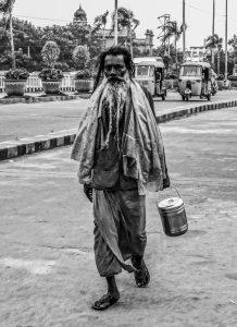 Sadhu walking on road