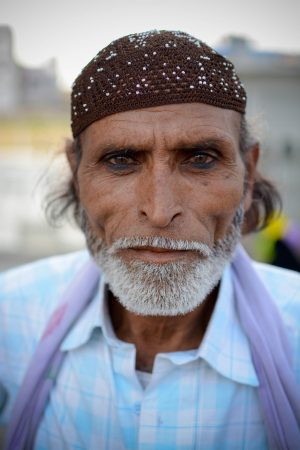 Portrait of a visitor to mecca masjid, hyderabad
