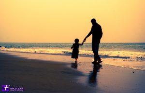 A Silhouette of Father & Daughter at the beach