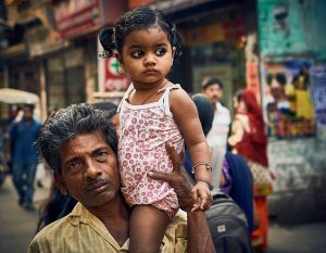 girl on her father's shoulder